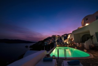 Luxurious Santorini hotel Kima Villas amazing night view of our Jacuzzi next to the Aegean Sea