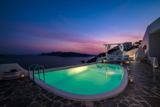 Luxurious Santorini hotel Kima Villas enchanting jacuzzi view by night