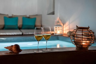 Luxurious Santorini hotel Kima Villas enjy a drink at night in our heated jacuzzi