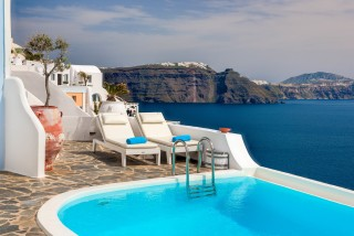 Luxurious Santorini hotel Kima Villas balcony with jacuzzi and unforgettable caldera view