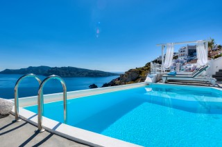 Luxurious Santorini hotel Kima Villas big jacuzzi overlooking the Greek Sea and Caldera