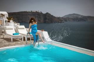 Luxurious Santorini hotel Kima Villas woman relaxes in the jacuzzi