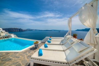 Luxurious Santorini hotel Kima Villas sea view jacuzzi area with sunbeds and minimal decoration