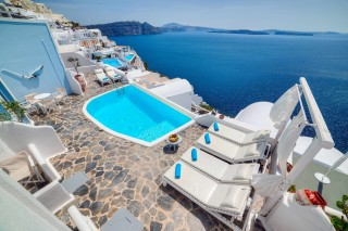 Luxurious Santorini hotel Kima Villas aerial view of the sea view balcony with jacuzzi
