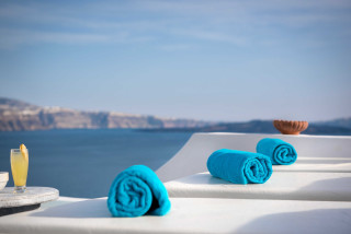Luxurious Santorini hotel Kima Villas Sunbeds for jacuzzi with sea and caldera view