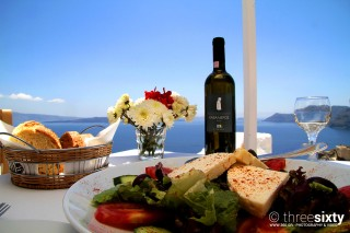 The best things to do in Santorini Kima Villas taste the delicious Greek salad and the local wine