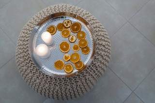 facilities of our santorini luxury hotel in oia kima villas candles and orange slices decoration