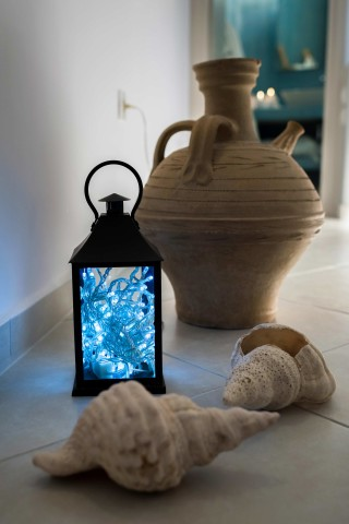facilities of our santorini luxury hotel in oia kima villas decoration with sea shells, lamps and Greek ceramics