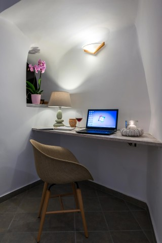 facilities of our santorini luxury hotel in oia kima villas laptop is provided for out guests in their rooms