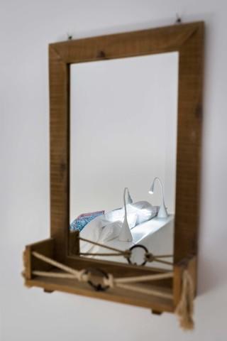 facilities of our santorini luxury hotel in oia kima villas mirror with bedroom reflection