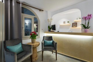 facilities of our santorini luxury hotel in oia kima villas reception area and lounge