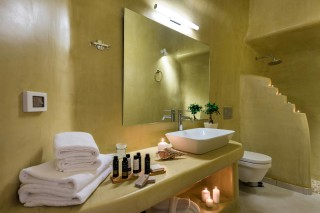 luxurious santorini suites kima villa big bathroom with shower and clean towels