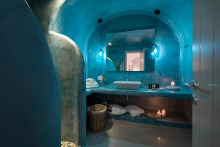 luxurious santorini suites kima villa big cycladic bathroom with candles and mirror