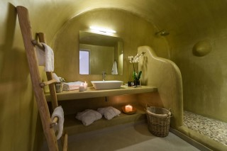 luxurious santorini suites kima villa big bathroom with shower, candles anc clean towels