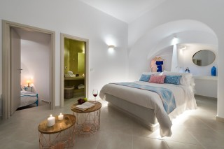 luxurious santorini suites kima villa double bedroom with wardrobe, bathroom and wine with fresh fruits