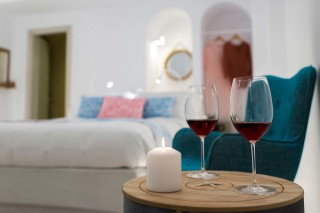 luxurious santorini suites kima villa deluxe double bedroom with welcome drink