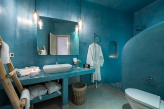 luxurious santorini suites kima villa big bathroom with shower, bath products, candles and bath robes