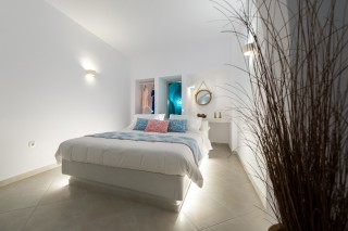luxurious santorini suites kima villa kima suite that has a big bedroom
