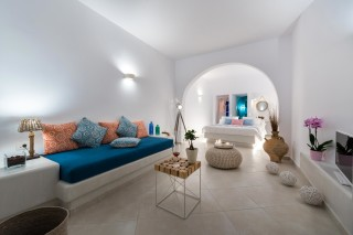 luxurious santorini suites kima villa comfortable living room area with sofa, table and big bedroom