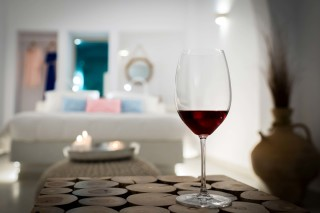 luxurious santorini suites kima villa elegant bedroom where you can taste a welcome wine drink