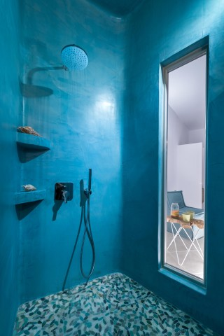 luxurious santorini suites kima villa cycladic shower next to the bedroom