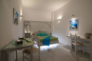 luxurious santorini suites kima villa bedroom with desk and other amenities