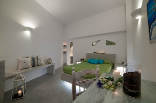 luxurious santorini suites kima villa big junior suite with built-in sofa, candles and desk