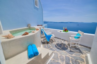 luxurious santorini suites kima villa outdoor heated jacuzzi with view of the Aegean Sea from the balcony