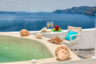 luxurious santorini suites kima villa sea view heated jacuzzi in the balcony where you can relax in the chairs