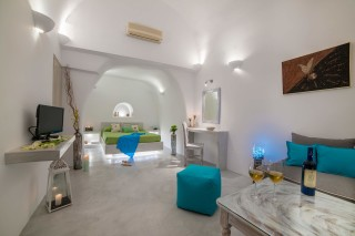 luxurious santorini superior cave suites kima villa big bedroom with cozy sitting area
