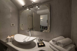 luxurious santorini superior cave suites kima villa bathroom with towels and bathroom products