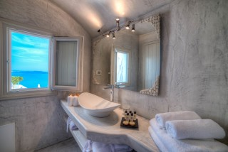 luxurious santorini superior cave suites kima villa bathroom with sea view and personal care products