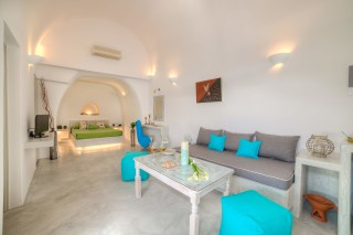 luxurious santorini superior cave suites kima villa big living room with sofa, air conditioning and flat screen TV next to the bedroom
