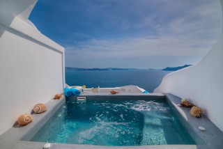 luxurious santorini superior cave suites kima villa heated jacuzzi with view of the Aegean Sea