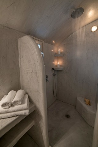 luxurious santorini superior cave suites kima villa shower with bath robes, slippers and clean towels