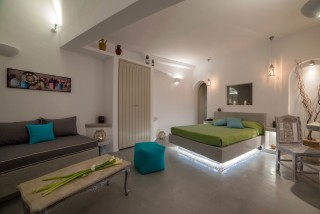 luxurious santorini superior suites kima villa big bedroom with wardrobe next to the living room