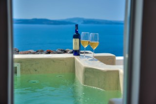 luxurious santorini superior suites kima villa outdoor heated jacuzzi with unique sea view and wine welcome drinks